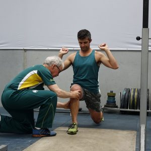 IMage shwing weightlifting instructor in action